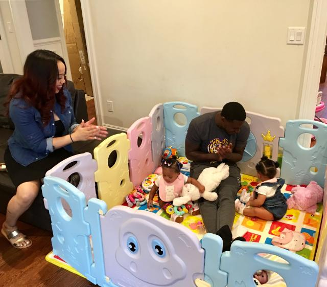 In this Thursday, June 14, 2018, photo, New York Jets cornerback Morris Claiborne plays with twin daughters MaKaila, left, and MaLiah as Claibornes wife, Jennifer, looks on at their home in Whippany, N.J. Last summer, Claiborne was trying to settle in with his new team, but his mind was on his newborn twins, one of whom was born underweight. (AP Photo/Dennis Waszak Jr.)