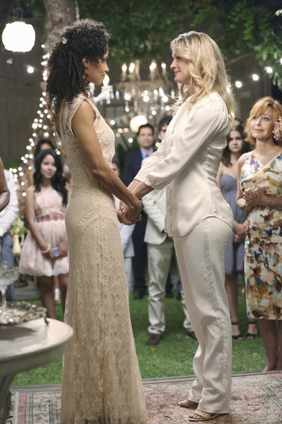 """This undated photo released by ABC Family shows, Sherri Saum, left, as Lena Adams, a school Vice Principal, and her partner, Teri Polo as Stef Foster, a dedicated police officer, in the TV series """"The Fosters,"""" airing Mondays, 9:00 - 10:00 P.m. ET/PT. The media advocacy group GLAAD released its annual study Friday, Oct. 11, 2013, of the number of lesbian, gay, bisexual and transgender characters on TV. (AP Photo/ABC Family, Adam Taylor)"""