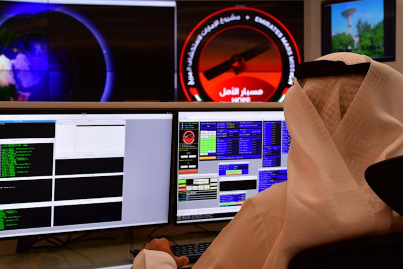 An employee works at the control room of the Mars Mission at the Mohammed Bin Rashid Space Centre, Dubai (AFP via Getty Images)