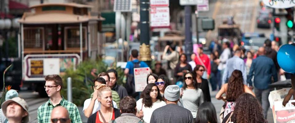 SAN FRANCISCO, CA - OCTOBER 17: Huge crowds of tourists, customers and locals stroll down Powell Street in San Francisco.