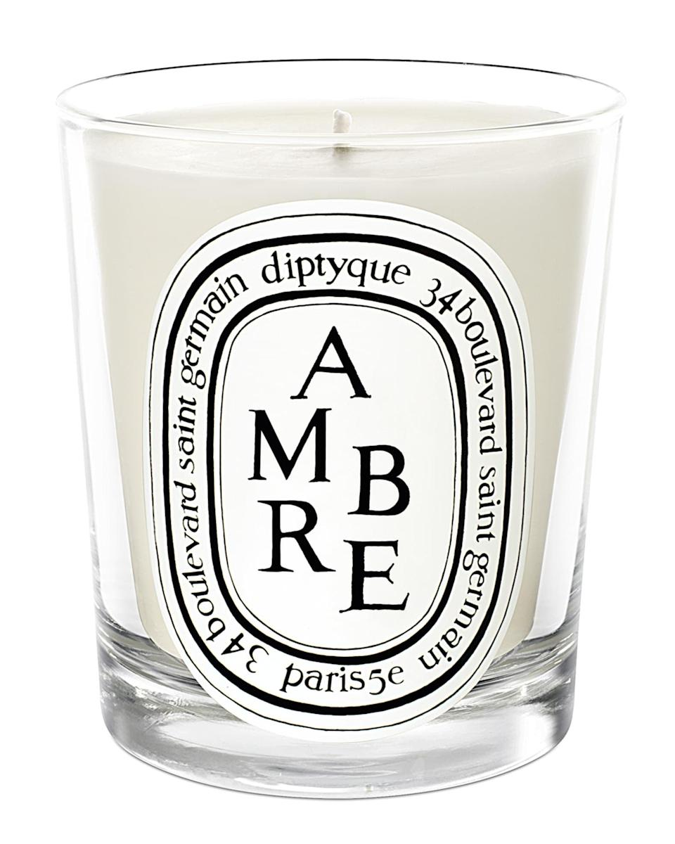 """<h3>Diptyque Ambre Scented Candle </h3><br>It totes a premium price tag, but with 4.7 out of 5 stars and $5,000+ reviews on <a href=""""https://www.google.com/shopping/product/4876609223892233070/reviews?prds=rsk:PC_1786674239562985426&sa=X&ved=0ahUKEwj698en4O3yAhUwGFkFHezdBBkQqSQIhAE"""" rel=""""nofollow noopener"""" target=""""_blank"""" data-ylk=""""slk:Google"""" class=""""link rapid-noclick-resp"""">Google</a> this spicy autumn scent in a hand-blown and amber-tinted glass container is worth the seasonal investment. <br><br>As one reviewer gushed: """"This is one of my all-time favorite candles from Diptyque. It has a really nice woody, spice scent that is beautiful in autumn and winter. I really like the beautiful colored glass of the bigger jars, which makes it even more special when it's out on display. I find that even when the candle isn't lit you can smell it faintly in a room which I really like.""""<br><br><em>Shop <strong><a href=""""https://www.diptyqueparis.com/en_us/p/ambre-amber-candle-190g.html"""" rel=""""nofollow noopener"""" target=""""_blank"""" data-ylk=""""slk:Neiman Marcus"""" class=""""link rapid-noclick-resp"""">Neiman Marcus</a></strong></em><br><br><strong>Diptyque</strong> Ambre Scented Candle, $, available at <a href=""""https://go.skimresources.com/?id=30283X879131&url=https%3A%2F%2Fwww.neimanmarcus.com%2Fp%2Fdiptyque-ambre-scented-candle-prod201330114"""" rel=""""nofollow noopener"""" target=""""_blank"""" data-ylk=""""slk:Neiman Marcus"""" class=""""link rapid-noclick-resp"""">Neiman Marcus</a>"""