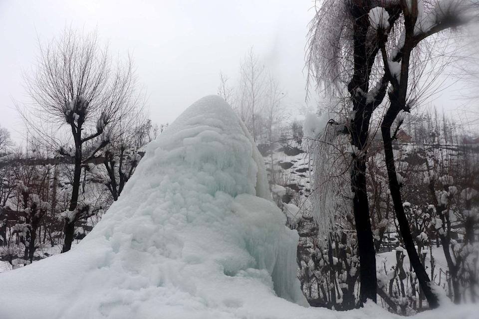 As the night temperature continues to fall in Kashmir, a small leakage in a water pipe leads to a formation of a mound of icicles.