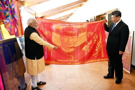 India's Prime Minister Narendra Modi and China's President Xi Jinping exchange gifts in Mamallapuram