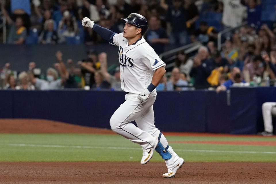 Tampa Bay Rays' Ji-Man Choi celebrates his solo home run against the Boston Red Sox during the sixth inning of Game 2 of a baseball American League Division Series, Friday, Oct. 8, 2021, in St. Petersburg, Fla. (AP Photo/Steve Helber)