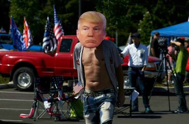 Trump supporters stage motorcade near protest-hit Portland