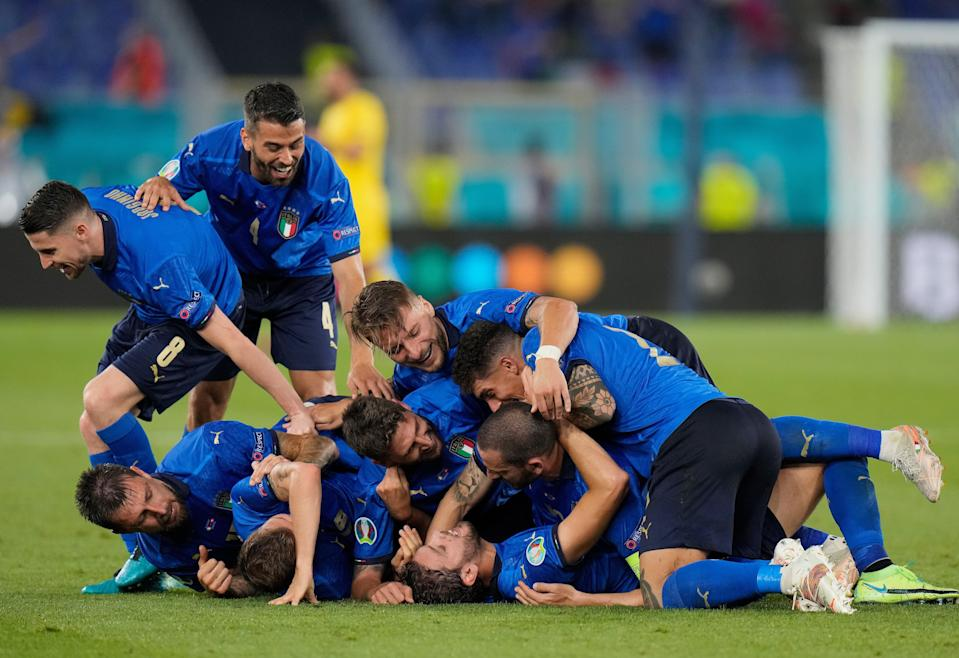 Manuel Locatelli of Italy celebrates with teammates after scoring a second goal against Switzerland (Getty)