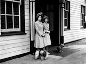 <p>Queen Elizabeth loves her dogs, and her affinity for animals dates to her earliest days. Here she is with her sister Princess Margaret and a few pups waiting at Ballater Station, near Balmoral Castle, in the 1940s.</p>
