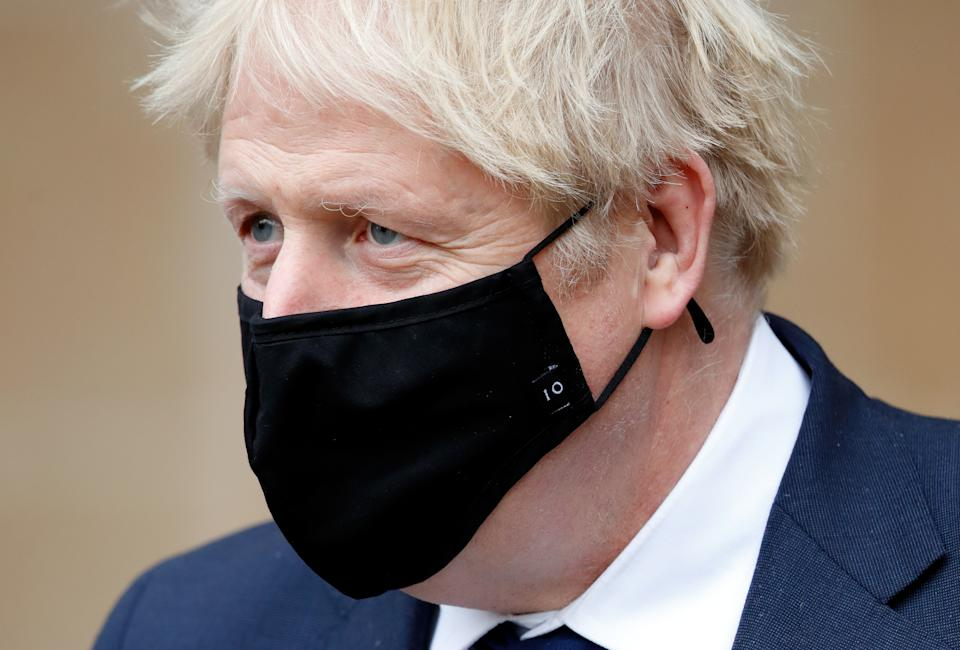 LONDON, UNITED KINGDOM - NOVEMBER 11: (EMBARGOED FOR PUBLICATION IN UK NEWSPAPERS UNTIL 24 HOURS AFTER CREATE DATE AND TIME) Prime Minister Boris Johnson (seen wearing a face mask with a number 10 embroidered into it) attends a service to mark the centenary of the burial of the Unknown Warrior at Westminster Abbey on November 11, 2020 in London, England. The service is to commemorate the funeral of an unknown British serviceman, the Unknown Warrior, whose body was brought from Northern France and buried at the west end of the nave in Westminster Abbey on 11th November 1920 to represent all those who lost their lives in the First World War but whose place of death was not known, or whose bodies remained unidentified. (Photo by Max Mumby/Indigo/Getty Images/Pool)