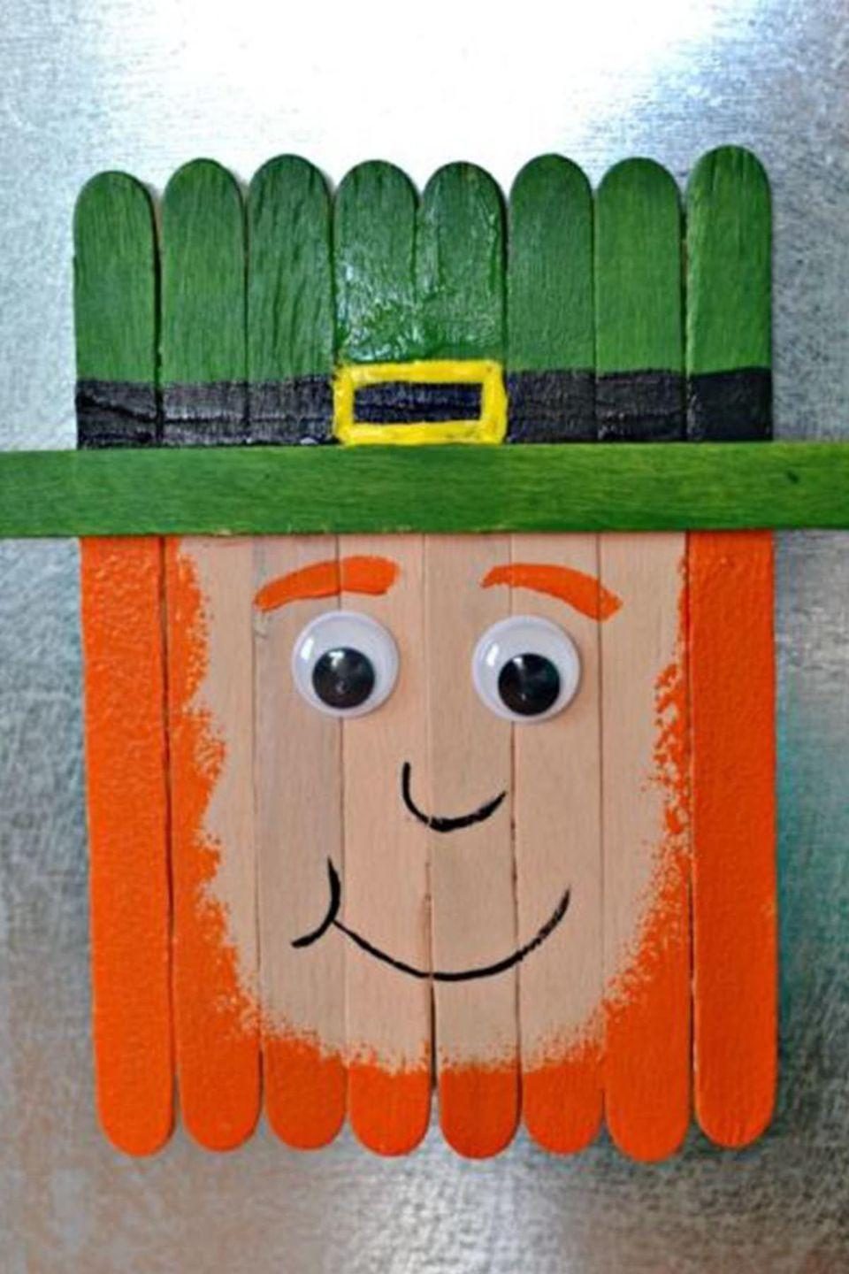 """<p>Popsicle sticks are so versatile when it comes to crafting. For St. Paddy's Day, turn them into <a href=""""https://www.womansday.com/relationships/family-friends/a54141/dad-turns-6-month-old-son-into-a-leprechaun/"""" rel=""""nofollow noopener"""" target=""""_blank"""" data-ylk=""""slk:a leprechaun"""" class=""""link rapid-noclick-resp"""">a leprechaun</a> magnet in just a few simple steps.</p><p><em>Get the tutorial at <a href=""""http://thisgirlslifeblog.com/2015/03/popsicle-stick-leprechaun-magnet.html"""" rel=""""nofollow noopener"""" target=""""_blank"""" data-ylk=""""slk:This Girl's Life"""" class=""""link rapid-noclick-resp"""">This Girl's Life</a>.</em> </p>"""
