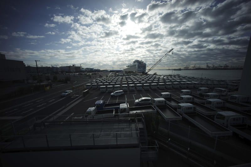 The quarantined Diamond Princess cruise ship is seen a port in Yokohama, near Tokyo, Wednesday, Feb. 19, 2020. The cruise ship begins letting passengers off the boat on Wednesday after it's been in quarantined for 14 days. (AP Photo/Eugene Hoshiko)