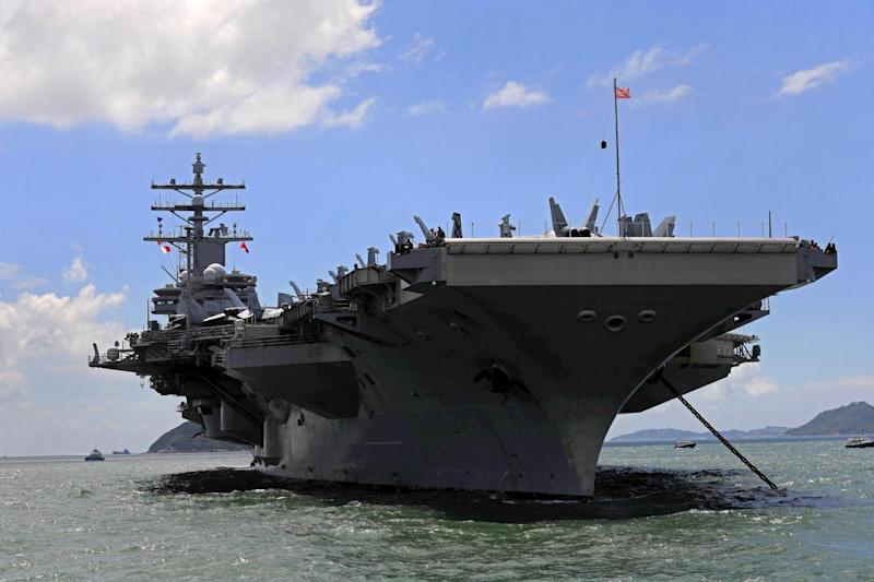The plane was carrying supplies to the USS Ronald Reagan aircraft carrier (AP)