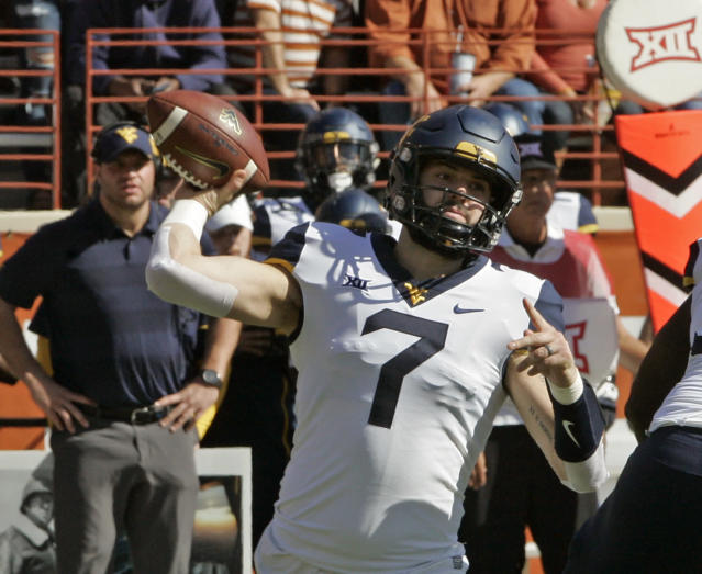 Will Grier plans on throwing at the NFL scouting combine, a necessity for him as there are questions about his arm strength at the pro level. (AP)