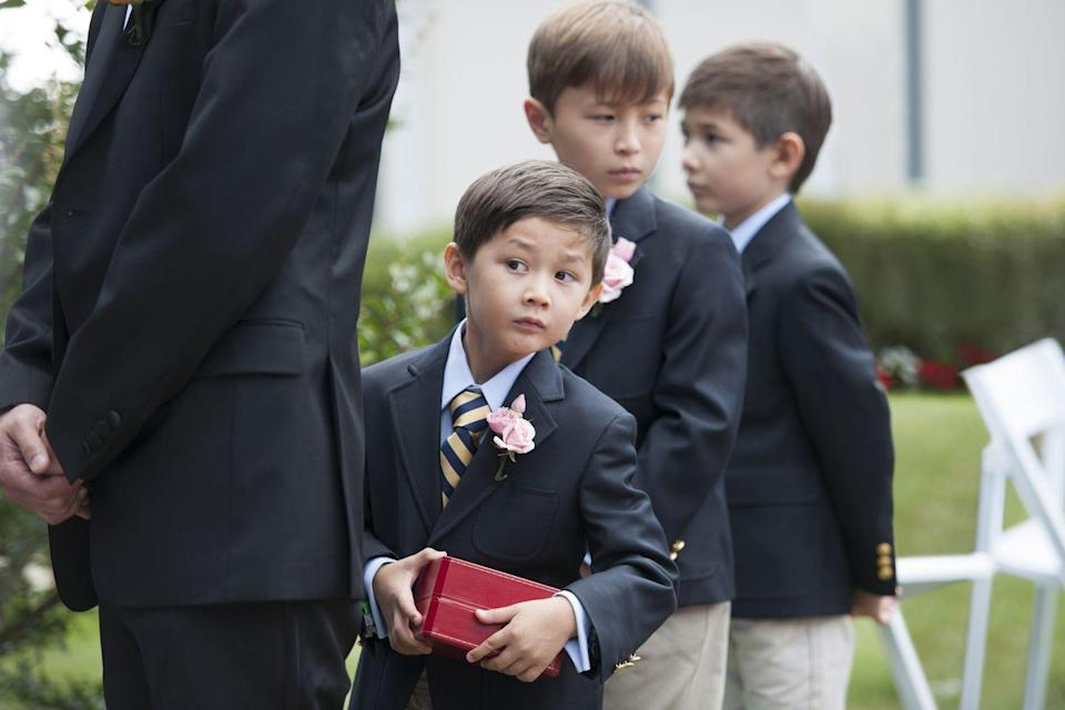 """<p>Reminder: Being a flower girl or ring bearer is already difficult for little ones. """"It's hard enough getting a toddler or little kid down the aisle with a job to do,"""" says Porter. """"They don't need you taking their attention off the matter at hand, namely throwing those petals.""""</p>"""