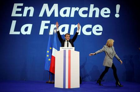 Emmanuel Macron, head of the political movement En Marche !, or Onwards !, and candidate for the 2017 French presidential election, gestures to supporters after the first round of 2017 French presidential election in Paris
