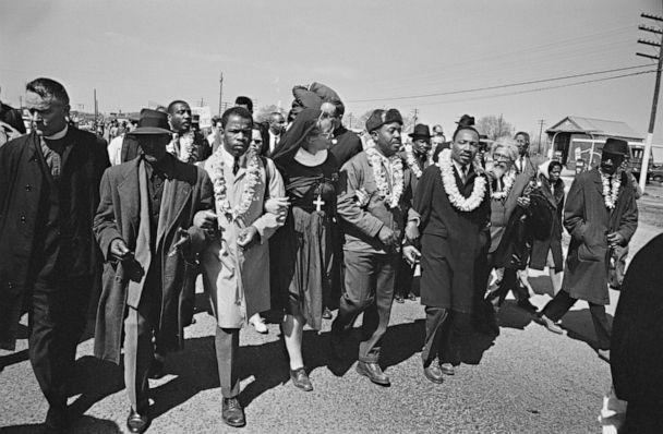 PHOTO: File photo of Dr. Martin Luther King Jr, right, arm in arm with Reverend Ralph Abernathy, center, leads marchers as they begin the Selma to Montgomery civil rights march from Brown's Chapel Church in Selma, Ala. on March 21, 1965. (William Lovelace/Hulton Archive via Getty Images)