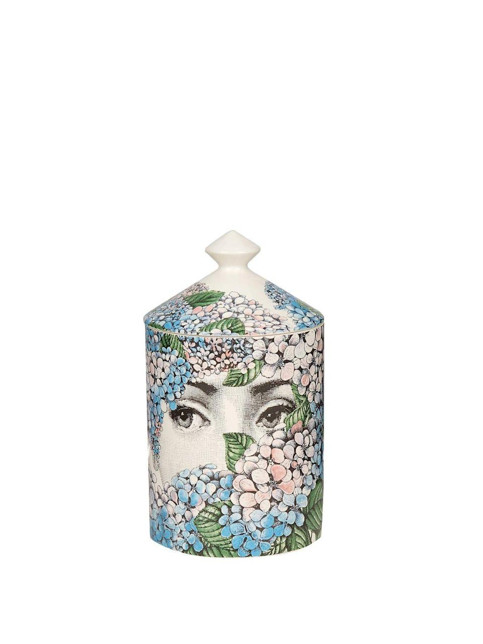 """<p><strong>Fornasetti</strong></p><p><strong>$165.00</strong></p><p><a href=""""https://go.redirectingat.com?id=74968X1596630&url=https%3A%2F%2Fwww.matchesfashion.com%2Fus%2Fproducts%2F1347777%3Fcountry%3DUSA%26rffrid%3Dsem.Google.n%253Dg.cid%253D1775457770.aid%253D71956807867.k%253D.mty%253D.d%253Dc.adp%253D.cr%253D343452211173.tid%253Daud-429262818371%253Apla-605358118702.pid%253D1347777000001.ppid%253D605358118702.lpm%253D9012934.adty%253Dpla.prl%253Den%26gclid%3DCj0KCQiA-aGCBhCwARIsAHDl5x_nFE7azvSF9LnjJlvlTRu8VFM6BPZGot2xxkv6Gi_4HMMjdlolBeMaAi50EALw_wcB%26gclsrc%3Daw.ds&sref=https%3A%2F%2Fwww.harpersbazaar.com%2Fwedding%2Fplanning%2Fg7719%2Funique-wedding-gift-ideas%2F"""" rel=""""nofollow noopener"""" target=""""_blank"""" data-ylk=""""slk:SHOP NOW"""" class=""""link rapid-noclick-resp"""">SHOP NOW</a></p><p>These beautiful options by Italian painter and engraver, Piero Fornasetti, have unique and whimsical designs glazed onto their ceramic vessels. Not only is the candle hand poured with 100% vegetal wax in Italy, but once it's burned away, the jar remains a beautiful decoration for the couple's home.</p>"""