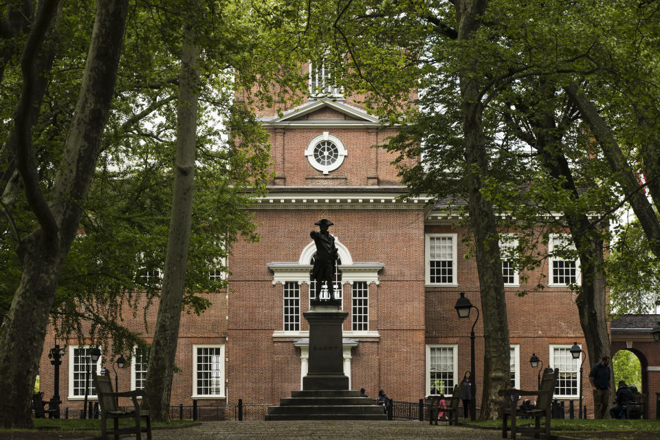 FILE - The exterior of Independence Hall appears in Philadelphia, on April 26, 2019. The location is featured in a collection of mini-essays by American writers published online by the Frommer's guidebook company about places they believe helped shape and define America. (AP Photo/Matt Rourke, File)