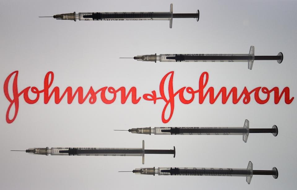 An illustrative image of medical syringes in front of Johnson and Johnson logo displayed on a screen. On Friday, January 8, 2020, in Dublin, Ireland. (Photo by Artur Widak/NurPhoto via Getty Images)