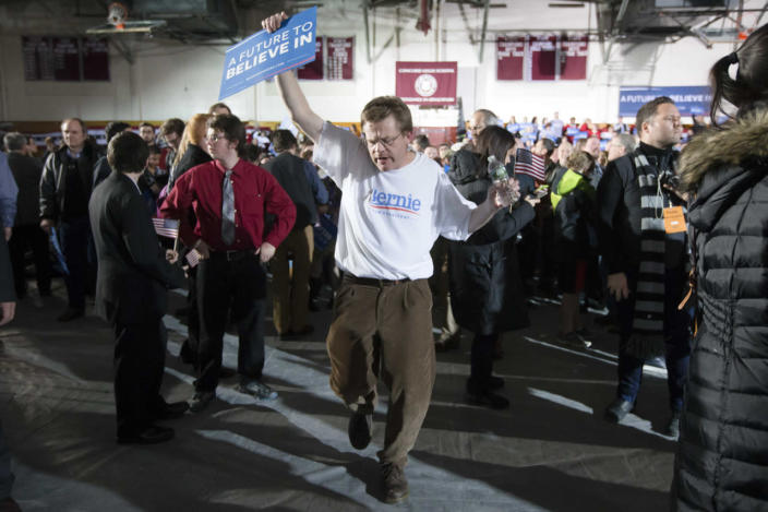 <p>A supporter of Democratic presidential candidate Sen. Bernie Sanders, I-Vt., dances during a primary-night watch party at Concord High School on Feb. 9, 2016, in Concord, N.H. (John Minchillo/AP)</p>