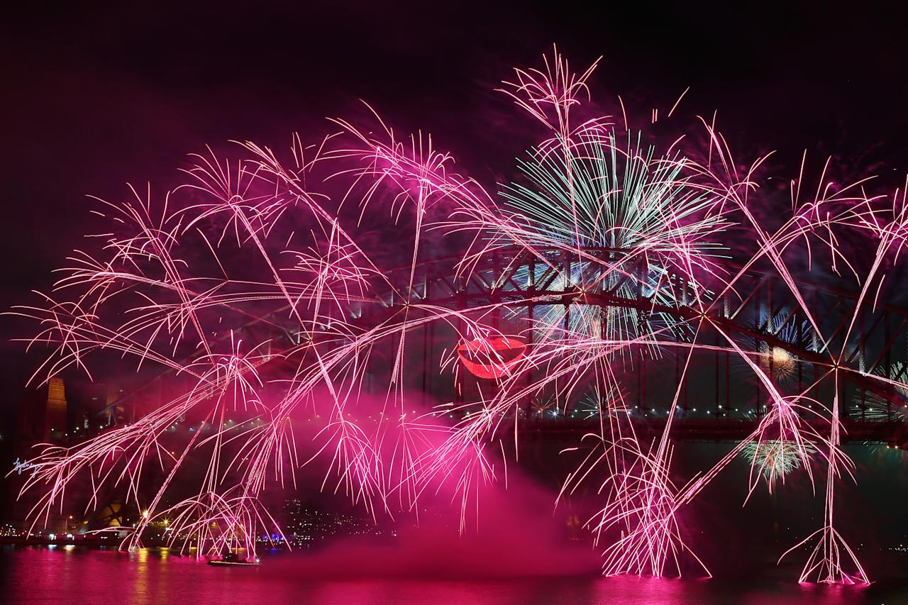 SYDNEY, AUSTRALIA - DECEMBER 31:  Fireworks light up the sky from The Sydney Harbour Bridge at midnight during New Years Eve celebrations on Sydney Harbour on December 31, 2012 in Sydney, Australia.  (Photo by Cameron Spencer/Getty Images)