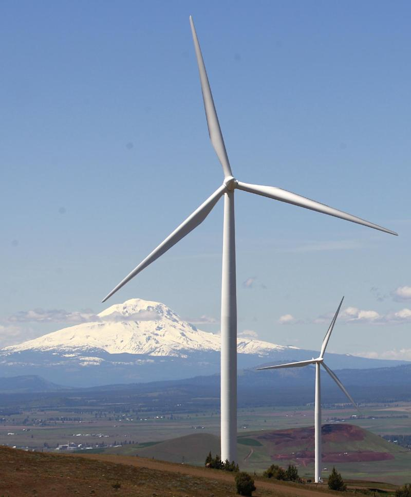 FILE - This June 3, 2011 file photo shows wind turbines on the Columbia Gorge near Goldendale, Wash.  Officials said Tuesday that the fate of a tax credit that advocates say is needed to maintain tens of thousands of wind energy jobs will be decided during high-stakes, last-minute negotiations between President Obama and House Republicans over fiscal issues. (AP Photo/Rick Bowmer, File)