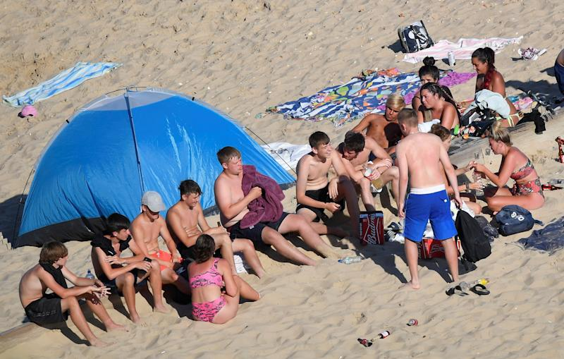 Groups of young people are seen on the beach in Bournemouth as they enjoy the hot weather after lockdown restrictions were eased following the outbreak of the coronavirus disease (COVID-19), Bournemouth, Britain, June 2, 2020. REUTERS/Toby Melville