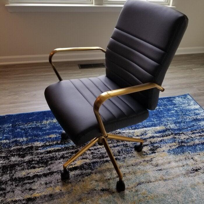 """<h2>Willa Arlo Interiors Turbeville Task Chair</h2><br>As we mentioned, this most wanted listicle contains such usual suspects as the <a href=""""https://refinery29.com/en-us/home-office-chairs-reviews"""" rel=""""nofollow noopener"""" target=""""_blank"""" data-ylk=""""slk:reliable office chair"""" class=""""link rapid-noclick-resp"""">reliable office chair</a> from Wayfair. Readers chose Willa Arlo's sleek (with a side of gold glam!) Task Chair for their new monthly favorite due to reviewer feedback on its solid lumbar support, back-angle adjustment, center-tilt capabilities, and comfy foam-filled leather cushions.<br><br><em>Shop <strong><a href=""""https://www.wayfair.com/furniture/pdp/willa-arlo-interiors-turbeville-task-chair-w001473431.html"""" rel=""""nofollow noopener"""" target=""""_blank"""" data-ylk=""""slk:Wayfair"""" class=""""link rapid-noclick-resp"""">Wayfair</a></strong></em><br><br><strong>Willa Arlo Interiors</strong> Turbeville Task Chair, $, available at <a href=""""https://go.skimresources.com/?id=30283X879131&url=https%3A%2F%2Fwww.wayfair.com%2Ffurniture%2Fpdp%2Fwilla-arlo-interiors-turbeville-task-chair-w001473431.html"""" rel=""""nofollow noopener"""" target=""""_blank"""" data-ylk=""""slk:Wayfair"""" class=""""link rapid-noclick-resp"""">Wayfair</a>"""