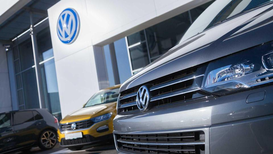 Volkswagen logo with cars at dealership in Fuerth Germany