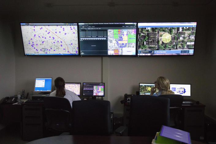 "FILE - In this Wednesday, Feb. 8, 2017 file photo, members of the Chicago Police Department work with new predictive and tracking ""ShotSpotter"" technologies in a strategic decision support center at the Chicago Police Department 11th district headquarters in Chicago. In a Monday, May 3, 2021 court filing, community groups argue the gunshot detection system routinely reports gunshots where there are none, sending officers into predominantly Black and Latino neighborhoods for ""unnecessary and hostile"" encounters. (Erin Hooley/Chicago Tribune via AP)"