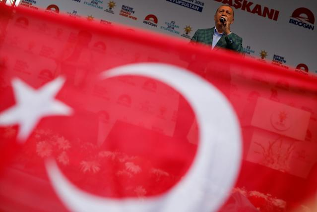 Turkish President Tayyip Erdogan addresses his supporters during an election rally in Istanbul, Turkey, June 23, 2018. REUTERS/Alkis Konstantinidis TPX IMAGES OF THE DAY