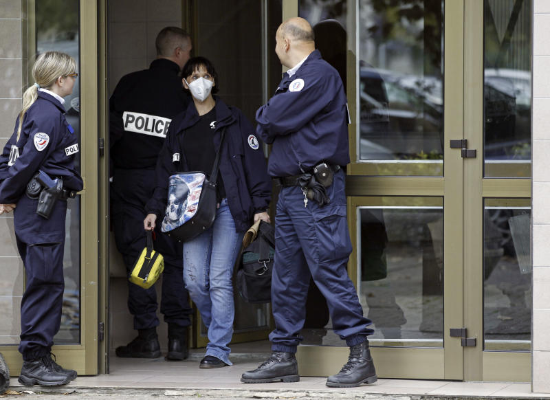 French police officers stand guard at the entrance of a building in Strasbourg, France, Saturday Oct. 6, 2012, where a suspect was shot dead after firing at police. French anti-terrorism forces carried out raids in cities nationwide on Saturday, at least five people were arrested in the investigation into the firebombing of a kosher grocery outside Paris last month. (AP Photo/Jean Francois Badias)