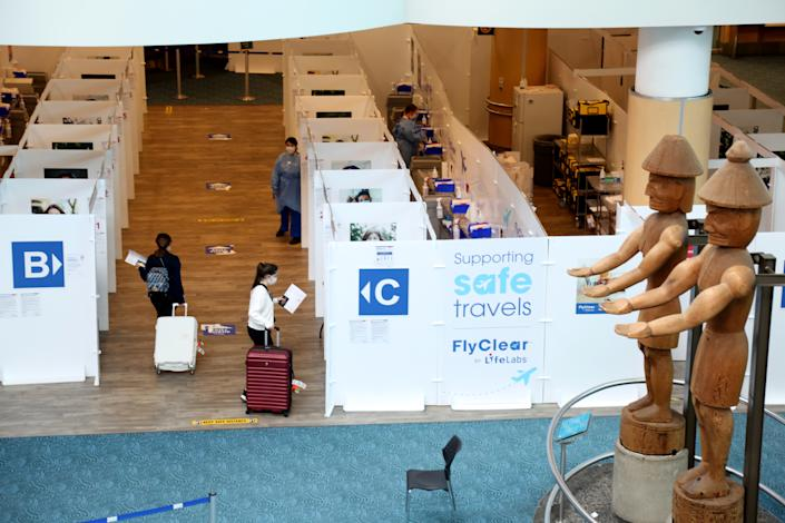 VANCOUVER, BC - MAY 2 :  Passengers from Turkey walk to COVID-19 testing area at Vancouver International Airport (YVR) in Vancouver, British Columbia, Canada on May, 2, 2021.  Turkish Airlines' service on Istanbul-Vancouver route has started on May 2, 2021. (Photo by Mert Alper Dervis/Anadolu Agency via Getty Images)
