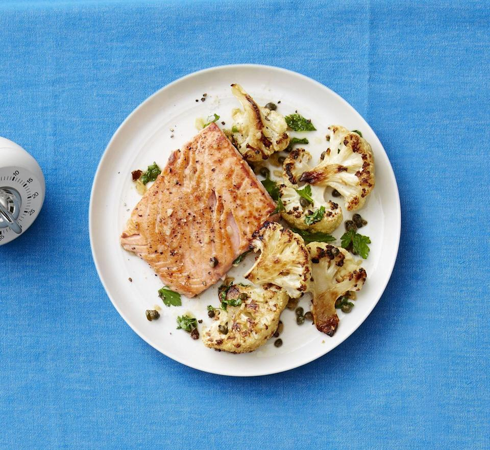 """<p>The garlic and capers perform double duty here, seasoning both the salmon and the cauliflower.</p><p><a href=""""https://www.womansday.com/food-recipes/food-drinks/recipes/a53278/seared-salmon-with-roasted-cauliflower/"""" rel=""""nofollow noopener"""" target=""""_blank"""" data-ylk=""""slk:Get the recipe from Woman's Day »"""" class=""""link rapid-noclick-resp""""> <em>Get the recipe from Woman's Day »</em></a></p>"""