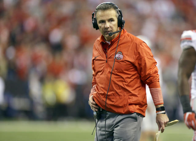 Ohio State head coach Urban Meyer watches from the sidelines during the second half of the Big Ten championship. (AP)