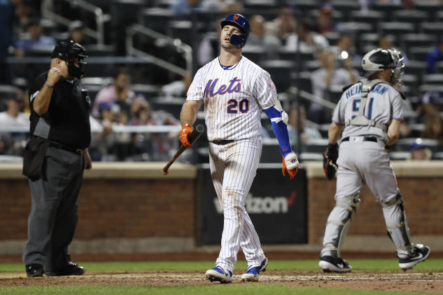 Home plate umpire Eric Cooper, left, gestures as New York Mets' Pete Alonso (20) reacts after striking out in his final at-bat with runners on base in the seventh inning of a baseball game against the Miami Marlins, Thursday, Sept. 26, 2019, in New York. (AP Photo/Kathy Willens)