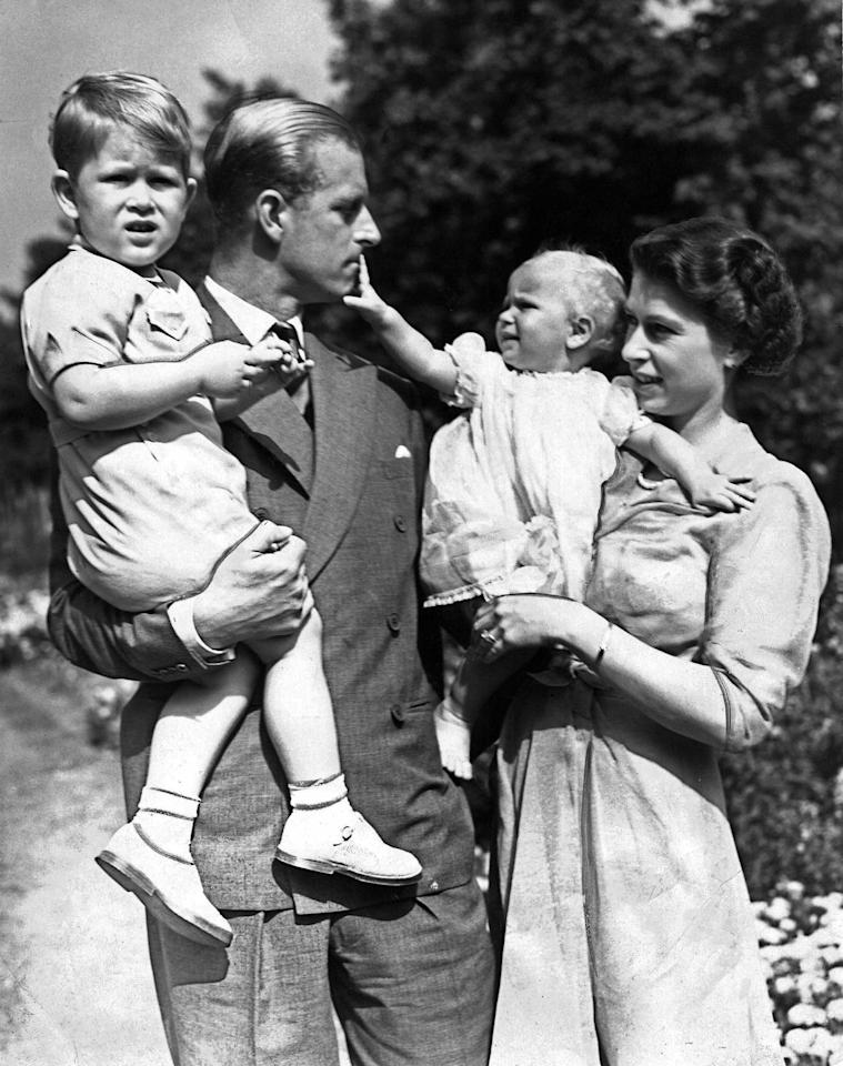 <p>A lil' Princess Anne with her mom, dad, and big brother Charles. </p>