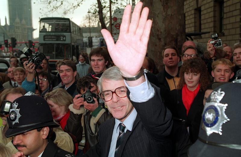 Then Chancellor John Major waves after Margaret Thatcher announced her resignation in 1990, paving the way for him to succeed her inside Number 10.