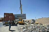 The road to Bagram is lined with dozens of scrap businesses
