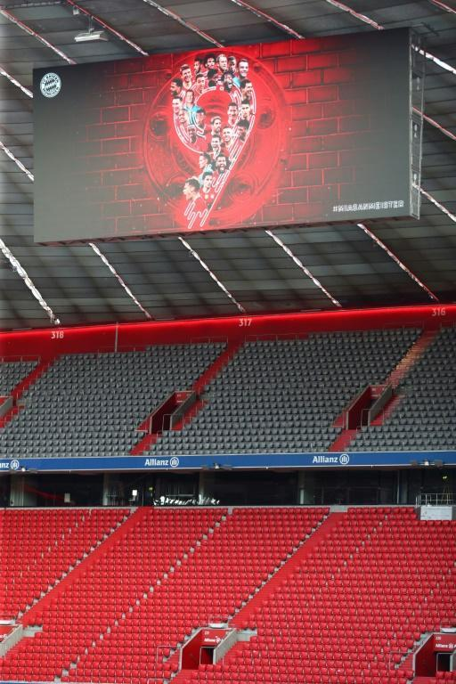 A board displaying the number nine is seen at the empty Allianz Arena after Bayern Munich were confirmed champions