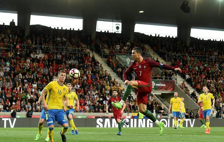 Portugal's forward Cristiano Ronaldo goes for the ball during the friendly football match Portugal vs Sweden at the Estadio dos Barreiros in Funchal on March 28, 2017