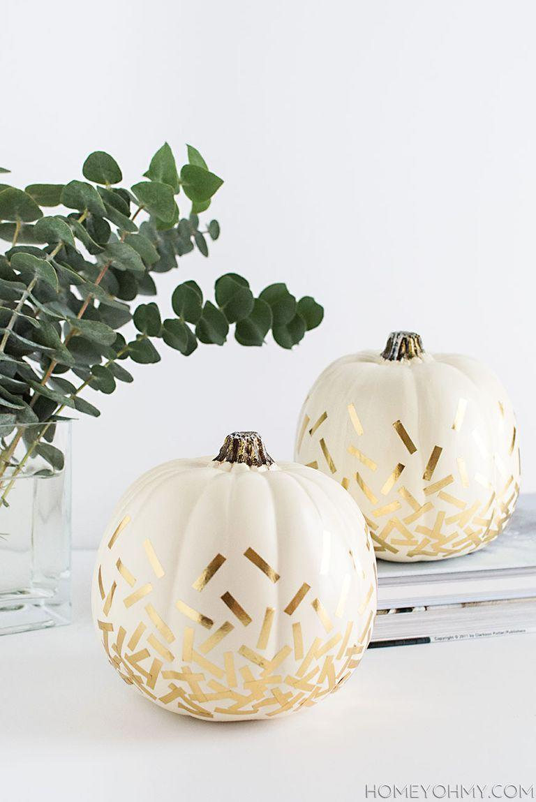 """<p>Metallic gold looks positively glamorous against the neutral background of these white pumpkins.</p><p><strong>Get the tutorial at <a href=""""https://www.homeyohmy.com/diy-confetti-pumpkins/"""" rel=""""nofollow noopener"""" target=""""_blank"""" data-ylk=""""slk:Homey Oh My"""" class=""""link rapid-noclick-resp"""">Homey Oh My</a>.</strong></p><p><strong><strong><a class=""""link rapid-noclick-resp"""" href=""""https://go.redirectingat.com?id=74968X1596630&url=https%3A%2F%2Fwww.walmart.com%2Fsearch%2F%3Fquery%3Dwashi%2Btape&sref=https%3A%2F%2Fwww.thepioneerwoman.com%2Fhome-lifestyle%2Fdecorating-ideas%2Fg36664123%2Fwhite-pumpkin-decor-ideas%2F"""" rel=""""nofollow noopener"""" target=""""_blank"""" data-ylk=""""slk:SHOP WASHI TAPE"""">SHOP WASHI TAPE</a></strong></strong></p>"""
