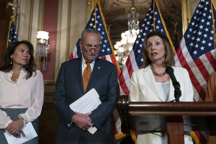 From left, Rep. Veronica Escobar, D-Texas, whose district contains El Paso, Texas, where a gunman killed 22 people at a Walmart, Senate Minority Leader Chuck Schumer, D-N.Y., and Speaker of the House Nancy Pelosi, D-Calif., call for a Senate vote on the House-passed Bipartisan Background Checks Act as Congress returns for the fall session with pressure mounting on Senate Majority Leader Mitch McConnell to address gun violence, at the Capitol in Washington, Monday, Sept. 9, 2019. (AP Photo/J. Scott Applewhite)