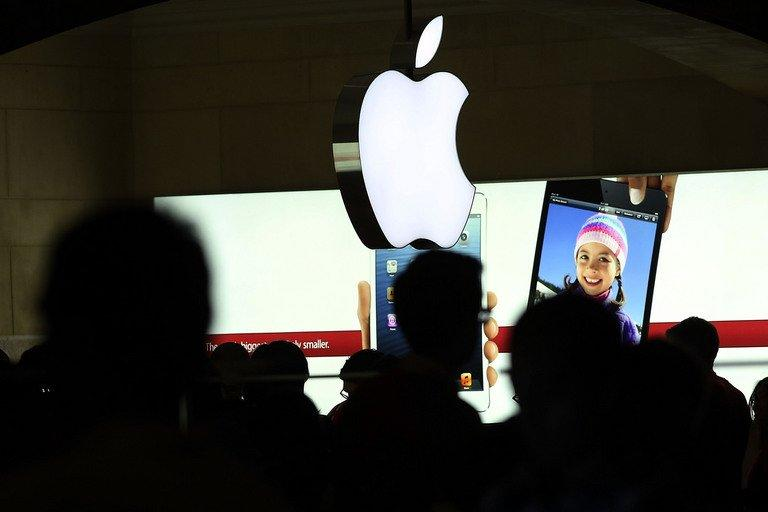 People walk through the Apple retail store in Grand Central Terminal on December 10, 2012 in New York City