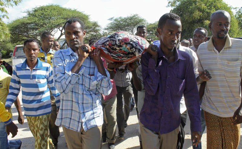 Mourners carry the body of Somali journalist Mohamed Mohamud to his burial in the capital Mogadishu, Somalia Sunday, Oct. 27, 2013. A Somali journalist says colleague Mohamed Mohamud, who also was known as Tima'ade and reported for the private U.K.-based Universal TV, has died of his wounds in hospital Saturday night after being shot six times by gunmen on Tuesday, bringing to seven the number of Somali journalists murdered this year, with at least 18 killed last year. (AP Photo/Farah Abdi Warsameh)