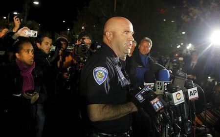 San Bernardino Police Chief Jarrod Burguan (C) speaks at a news conferenece, informing the media, that the couple Syed Rizwan Farook, 28, and Tashfeen Malik, 27, were responsible for the shooting rampage at the Inland Regional Center, in San Bernardino, California December 2, 2015. REUTERS/Alex Gallardo