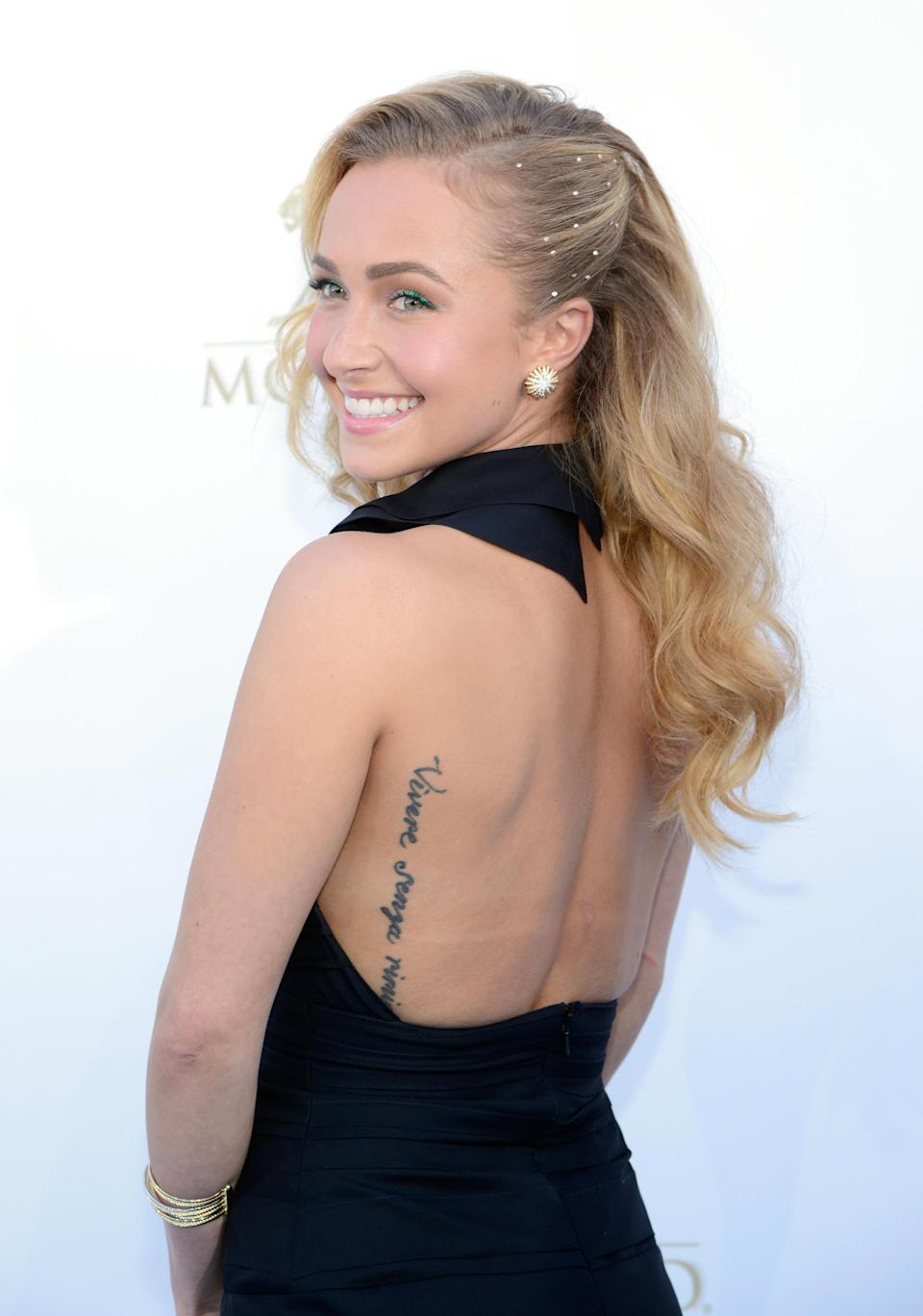 """<p>Poor <b>Hayden Panettiere</b>! The actress' tattoo says, """"Vivere senza rimpianti,"""" which is Italian for """"live without regrets."""" Sadly for her, it's misspelled. It should be """"rimpanti."""" We wonder if she has any regrets about that! Still, it looks cute whenever she wears a backless dress—and she talks about the gaffe openly <a href=""""http://metro.co.uk/2011/04/27/hayden-panettiere-regrets-misspelt-tattoo-fail-653640/"""" rel=""""nofollow noopener"""" target=""""_blank"""" data-ylk=""""slk:and makes light of it"""" class=""""link rapid-noclick-resp"""">and makes light of it</a>. </p>"""