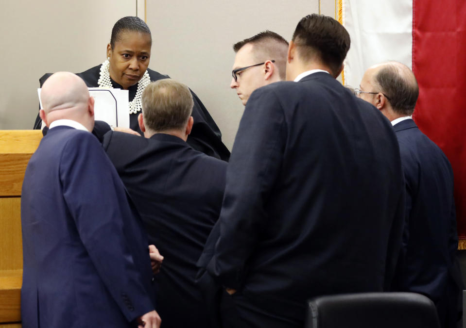 Judge Tammy Kemp calls prosecutors and defense attorneys to the bench during pretrial arguments in the Amber Guyger murder trial in the 204th District Court in Dallas, Monday, September 23, 2019. Guyger shot and killed Botham Jean, an unarmed 26-year-old neighbor in his own apartment last year. She told police she thought his apartment was her own and that he was an intruder. (Tom Fox/The Dallas Morning News, Pool)