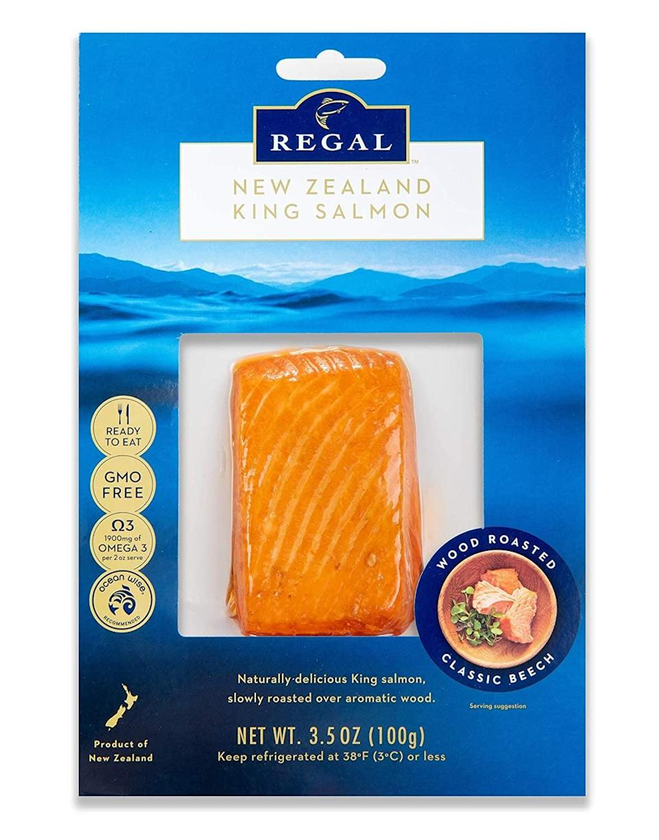 """<p>While eating seafood like salmon is linked to a slew of benefits, including <a href=""""https://pubmed.ncbi.nlm.nih.gov/23034965/"""" class=""""link rapid-noclick-resp"""" rel=""""nofollow noopener"""" target=""""_blank"""" data-ylk=""""slk:reduced inflammation and body fat tissue"""">reduced inflammation and body fat tissue</a> in some populations, you probably don't have time to whip up a cooked salmon dish during the morning rush. </p> <p>Enter: <span>Regal New Zealand Salmon</span> ($85 for an eight-pack), a smoked and pre-cooked salmon option that tastes better than most dishes you'll find at a restaurant. Antibiotic-free, non-GMO, and sustainably raised, this salmon makes eating fish in the morning actually doable. It comes pre-portioned, so all you have to do is thaw, unwrap, and enjoy. Pair your salmon with some rye crisps and sliced cucumber and tomato for a decadent breakfast.</p>"""