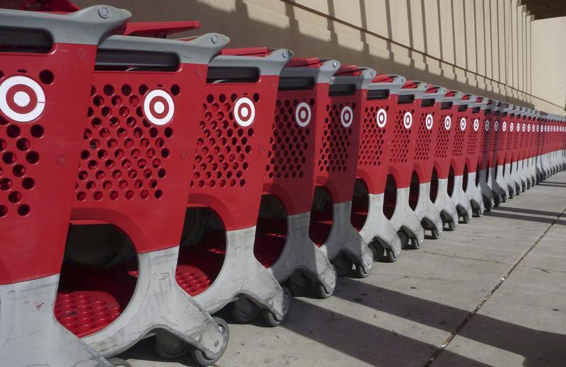 Merchandise baskets are lined up outside a Target department store in Palm Coast, Florida