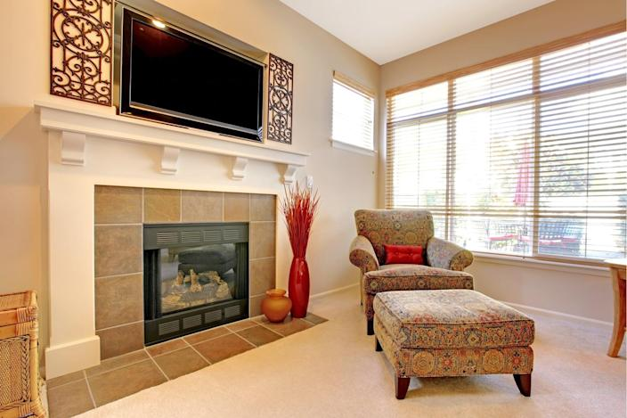 The spot above the fireplace might seem perfect for a flat-screen at first glance, but it means robbing yourself of a beautiful aesthetic focal point.